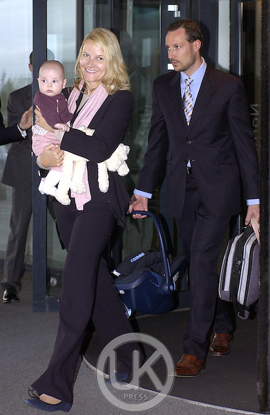Crown Prince Haakon & Crown Princess Mette-Marit of Norway leave the Hotel Nordica, with baby Ingrid Alexandra, at the end of their visit to Iceland.