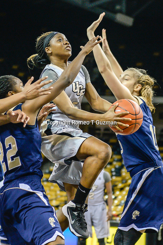 November 15, 2013 - Orlando, FL, U.S: UCF guard Zykira Lewis (5) drives for a layup during second half women's NCAA basketball game action between the FIU Panthers and the UCF Knights. UCF defeated FIU 71-66 at CFE Arena in Orlando, Fl.