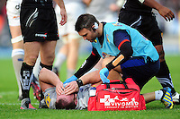 Henry Thomas of Bath Rugby is treated for a knock to the head by Physiotherapist Damien Kelly during a break in play. Aviva Premiership match, between Exeter Chiefs and Bath Rugby on October 30, 2016 at Sandy Park in Exeter, England. Photo by: Patrick Khachfe / Onside Images