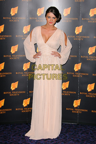 Brooke Vincent.Arrivals at the RTS Programme Awards 2012, London, England..March 20th, 2012.full length dress hands on hips cut out away white beige cleavage hair up bun side  .CAP/CJ.©Chris Joseph/Capital Pictures.