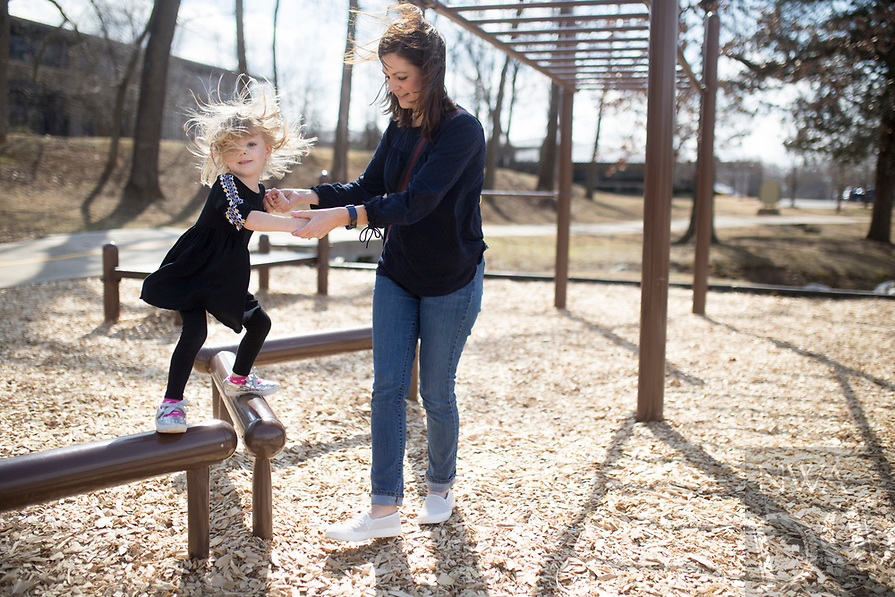 NWA Democrat-Gazette/CHARLIE KAIJO Julie Minteer of Centerton (from right) plays with Olivia Minteer, 3, on the outdoor gym, Thursday, February 15, 2018 along the Razorback Greenway in Bentonville. <br /><br />Benton County leads the state in county health rankings