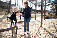 NWA Democrat-Gazette/CHARLIE KAIJO Julie Minteer of Centerton (from right) plays with Olivia Minteer, 3, on the outdoor gym, Thursday, February 15, 2018 along the Razorback Greenway in Bentonville. <br />