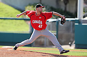 Team Canada Pitcher/Pitching Coach Mike Johnson #47 delivers a pitch delivers a pitch during a game vs the Nexen Heroes at Al Lang Field in St. Petersburg, Florida;  February 28, 2011.  Canada defeated Nexen 2-0.  Photo By Mike Janes/Four Seam Images