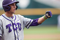 TCU Horned Frogs first baseman Jeremie Fagnan (32) heads to the dugout after scoring against the LSU Tigers in the NCAA College World Series on June 14, 2015 at TD Ameritrade Park in Omaha, Nebraska. TCU defeated LSU 10-3. (Andrew Woolley/Four Seam Images)