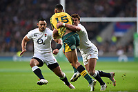 Israel Folau of Australia is tackled by Henry Slade of England. Quilter International match between England and Australia on November 24, 2018 at Twickenham Stadium in London, England. Photo by: Patrick Khachfe / Onside Images