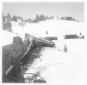 D&amp;RGW wreck of #498 and #497 on Feb, 10, 1960 west of Los Pinos.  A K-37 rescue engine is standing by.<br /> D&amp;RGW  Los Pinos, CO  2/1960