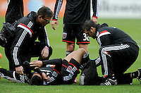 Washington, D.C.- March 29, 2014. Luis Silva (11) of D.C. United gets injured during the game. The Chicago Fire tied D.C. United 2-2 during a Major League Soccer Match for the 2014 season at RFK Stadium.