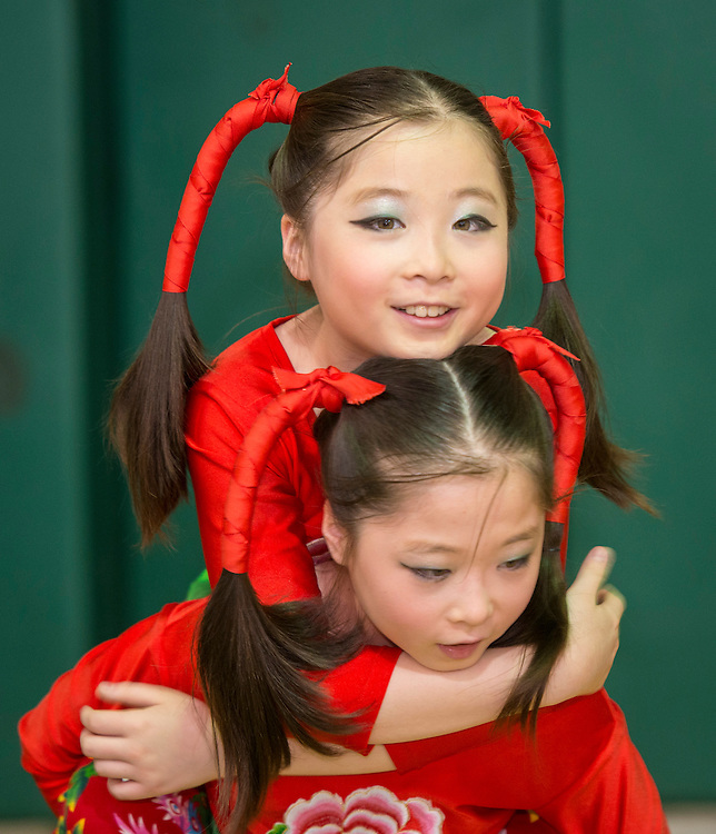 Students from Kolter Elementary School get ready to perform during a district wide celebration of the Chinese New Year at Sharpstown International School, February 22, 2014.