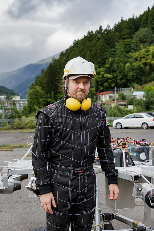 Minakami, Gunma prefecture, Japan, September 29 2016 - Beau Retallick is an Australian citizen based in Japan and the founder of Bungy Japan, a pioneer bungy jumping company in Japan. Beau Retallick is also an inventor and uses the money earned from bungy jumping to various projects. His latest invention is a jet powered drone with enough thrust to levitate a sumo wrestler.<br /> Beau Retallick posing with his drone after a test.