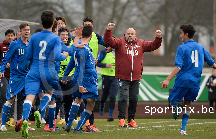 20150323 - MARBURG , GERMANY  : Italian coach Bruno Tedino (middle) pictured celebrating as his team scored the 1-0 during the soccer match between Under 17 teams of Slovakia and Italy , on the second matchday in group 8 of the UEFA Elite Round Under 17 at Georg-Gassmann , Marburg Germany . Monday 23 rd  March 2015 . PHOTO DAVID CATRY