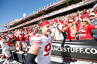 Ohio State Buckeyes defensive lineman Joey Bosa (97) gets high fives from fans as he leaves the field following the Buckeyes' 52-24 win over the Maryland Terrapins during the NCAA football game at Byrd Stadium in College Park, Maryland on Oct. 4, 2014. (Adam Cairns / The Columbus Dispatch)