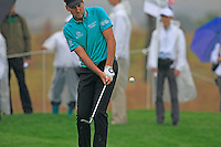 Ian Poulter (ENG) chips onto the 1st green during Thursday's Round 1 of the 2014 BMW Masters held at Lake Malaren, Shanghai, China 30th October 2014.<br /> Picture: Eoin Clarke www.golffile.ie