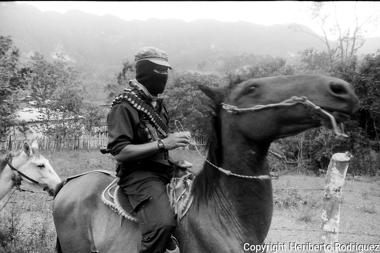 Zapatista rebel Subcomandante Marcos rides his horse as he arrives to the Zapatista stronghold La Garrucha village in the Lacandonian jungle in southern state of Chiapas, March 22, 1994.  Photo by Heriberto Rodriguez