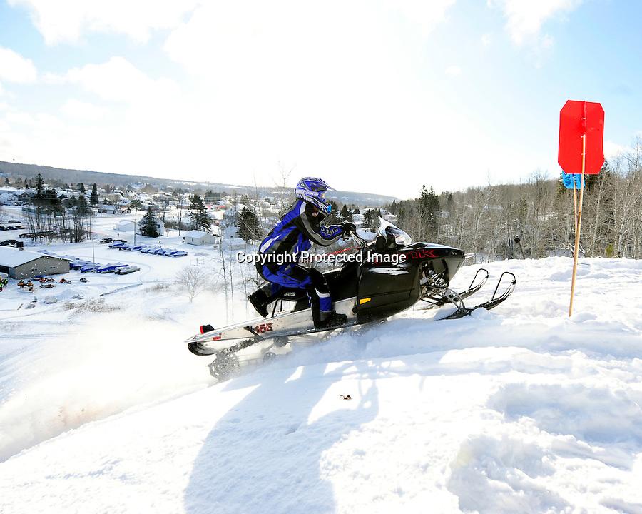 No. xxx climbs the Caspian Ski Hill during the 2013 MASTERS Hillclimb in Caspian, MI on Saturday, Feb. 16.