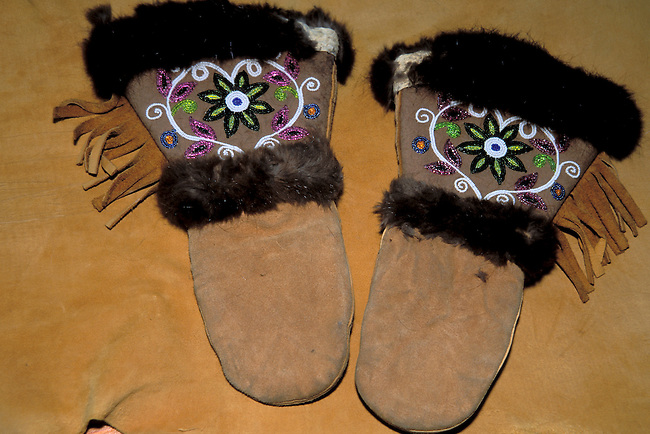 Pair of Chippewa fur lined moose hide mittens with beadwork