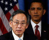 Chicago, IL - December 15, 2008 -- United States President-elect Barack Obama (R) listens to Nobel physics laureate Steven Chu (L) his nominee for energy secretary during a news conference in Chicago, Illinois on Monday, December 15, 2008. .Credit: Jeff Haynes / CNP