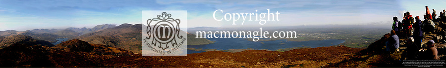 A panorama view from the summit of Torc Mountain, Killarney, overlooking the Upper Lake (on left, the Middle Lake, (centre) and The Lower Lake with walkers taking in the breathtaking view. Carrauntoohill mountain and the town of Killarney can also be seen.<br /> Picture by Don MacMonagle