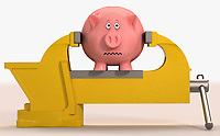Worried piggy bank being squeezed in vice grip