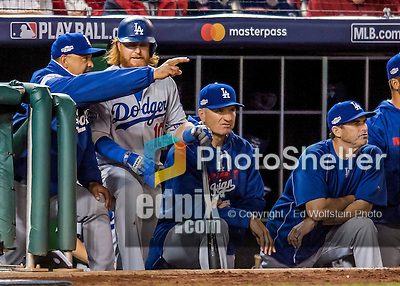 13 October 2016: Los Angeles Dodgers third baseman Justin Turner listens to Manager Dave Roberts on the steps of the dugout during the NLDS Game 5 against the Washington Nationals at Nationals Park in Washington, DC. The Dodgers edged out the Nationals 4-3, to take Game 5, and the Series, 3 games to 2, moving on to the National League Championship against the Chicago Cubs. Mandatory Credit: Ed Wolfstein Photo *** RAW (NEF) Image File Available ***
