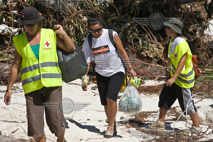 Red Cross volunteers searching the beaches in the Aleipata District. More than 170 people died when a tsunami triggered by an 8.3 magnitude earthquake hit Samoa and neighbouring Pacific islands on 29/09/2009. Samoa (formerly known as Western Samoa)..