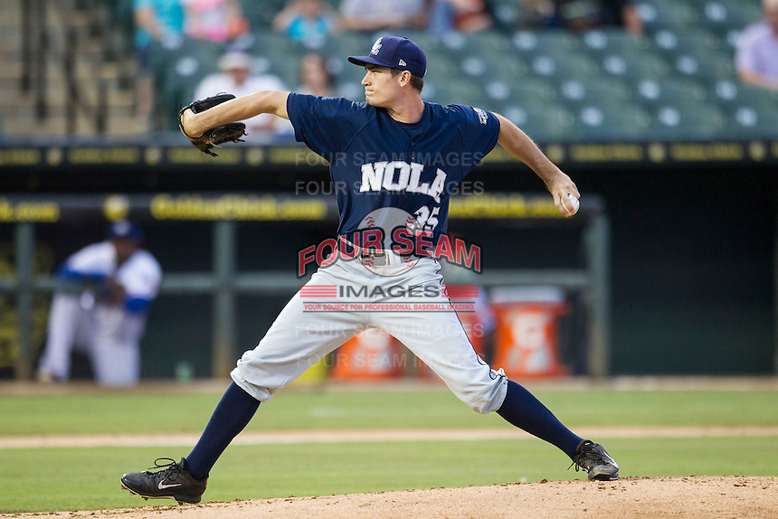 New Orleans Zephyrs starting pitcher Andrew Heaney (35) delivers a pitch to the plate during the Pacific Coast League baseball game against the Round Rock Express on May 27, 2014 at the Dell Diamond in Round Rock, Texas. In his second AAA start, Heaney allowed just one hit over six innings as the Zephyrs defeated the Express 9-0 in a rain shortened game. (Andrew Woolley/Four Seam Images)