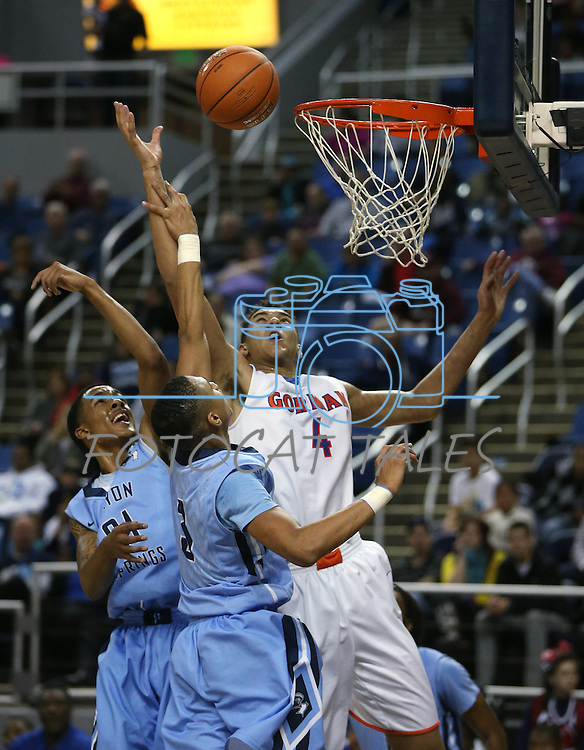 Gorman's Chase Jeter shoots over Canyon Springs defenders Darrell McCall and Jordan Davis during the Division I championship game in the NIAA basketball state tournament at Lawlor Events Center, in Reno, Nev., on Friday, Feb. 28, 2014. (Cathleen Allison/Las Vegas Review-Journal)