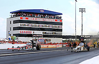 Aug. 31, 2013; Clermont, IN, USA: NHRA top fuel dragster driver Tony Schumacher (right) races alongside Steve Torrence during qualifying for the US Nationals at Lucas Oil Raceway. Mandatory Credit: Mark J. Rebilas-