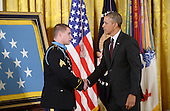 United States President Barack Obama, right, shakes hands with Kyle J. White, left, a former active duty U.S. Army Sergeant, to whom he awarded the Medal of Honor for conspicuous gallantry in the East Room of the White House, May 13, 2014 in Washington, DC. <br /> Credit: Olivier Douliery / Pool via CNP