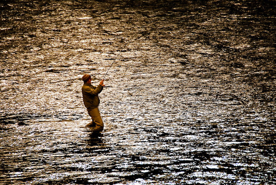 An angler fights a rainbow trout on the Madison River in the Lee Metcalf Wilderness near Bozeman, Montana.