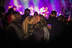 © Joel Goodman - 07973 332324 . 14/09/2013 . Bury , UK . A couple kiss passionately as Richard Hawley performs a love song on the Main Stage . The Ramsbottom Festival . Photo credit : Joel Goodman