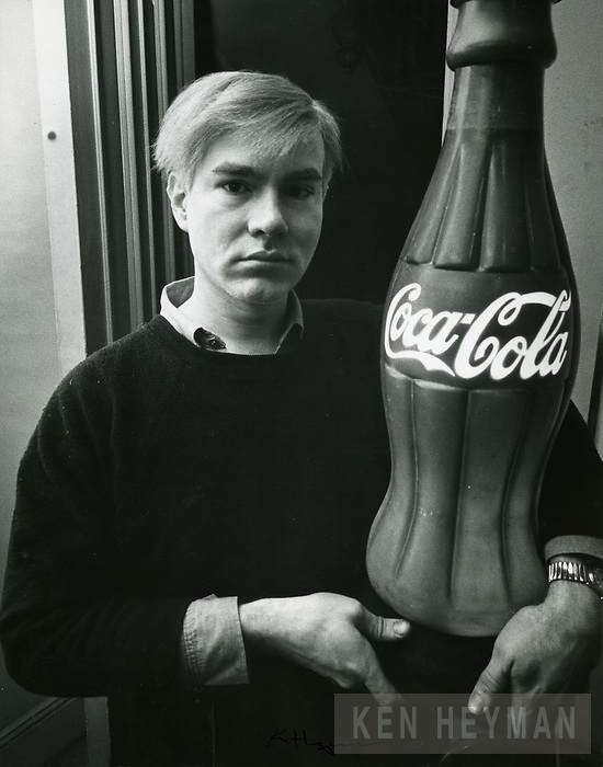 Andy Warhol with Coke Bottle
