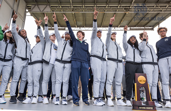 "April 2, 2018; Head coach Muffet"" McGraw and team members celebrate on stage during the Welcome Home event on south quad. Students and fans gathered on campus to welcome home the women's basketball team after their win in the NCAA National Championship. (Photo by Barbara Johnston/University of Notre Dame)"