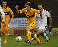 Nicky Law being closed down by Gavin Rae in the Motherwell v Aberdeen, Clydesdale Bank Scottish Premier League match at Fir Park, Motherwell on 26.12.12.