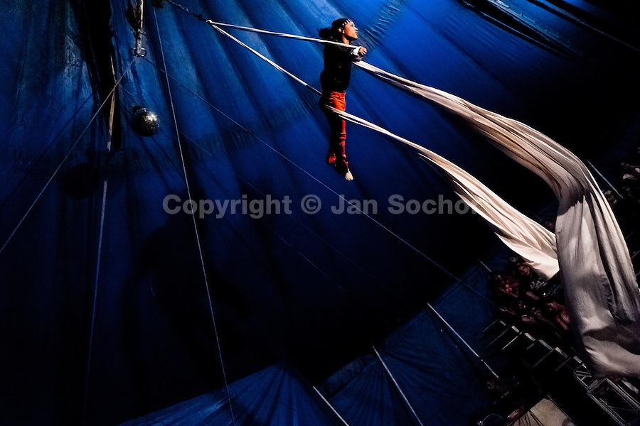 A Salvadorean man performs an aerial fabric acrobatics act at the Circo Brasilia, a family run circus travelling in Central America, 10 May 2011. The Circo Brasilia circus belongs to the old-fashioned traveling circuses with a usual mixture of acrobat, clown and comic acts. Due to the general loss of popularity caused by modern forms of entertainment such as movies, TV shows or internet, these small family enterprises balance on the edge of survival. Circuses were pushed away and now they have to set up their shows in more remote villages. The circus art and culture is slowly dying in Latin America.
