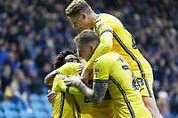 Andre Ayew of Swansea City is mobbed by team mates as he celebrates his goal during the Sky Bet Championship match between Sheffield Wednesday and Swansea City at Hillsborough Stadium, Sheffield, England, UK. Saturday 09 November 2019