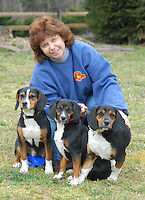 HOCKESSIN, DE - JANUARY 21: Members of Delaware Puppy Rescue poses and play with some of the puppies they helps nurse back from illness January 21, 2007, in Hockessin, Delaware. (Photo by William Thomas Cain)
