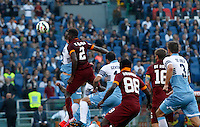 Calcio, Serie A: Lazio vs Roma. Roma, stadio Olimpico, 25 maggio 2015.<br /> Roma's Mapou Yanga-Mbiwa, left, heads to score the winning goal during the Italian Serie A football match between Lazio and Roma at Rome's Olympic stadium, 25 May 2015. Roma won 2-1.<br /> UPDATE IMAGES PRESS/Riccardo De Luca