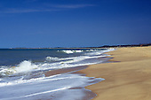 Porto Seguro, Bahia, Brazil. Waves breaking on the golden sand of the beach at Santa Cruz de Cabralia.