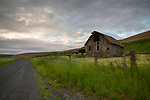 Idaho/Washington state line area. Moscow, the Palouse. An old barn and country road in hte dawn light of early spring.
