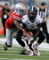 Ohio State Buckeyes safety Khaleed Franklin (3) slaps a pass down as Cincinnati Bearcats wide receiver Johnny Holton (3) falls to catch it in the 1st quarter of a football game between The Ohio State Buckeyes and the University of Cincinnati Bearcats on Saturday, September 27, 2014 at Ohio Stadium in Columbus. (Columbus Dispatch photo by Fred Squillante)