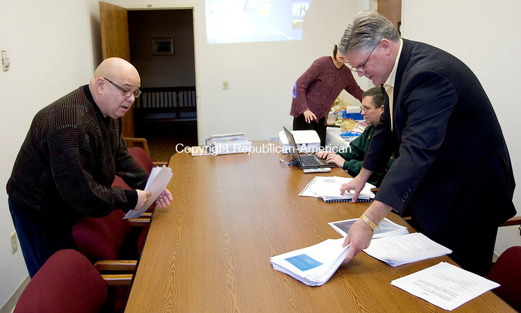 WINSTED, CT. 02 January 2012-010212SV01-From left, Dr. Joseph Castagnola of New Milford, and Dr. Thomas Danehy, superintendent of schools, prepare to speak during a presentation to the board of selectman and the facilities committee in Winsted Monday.  Castagnola is the consultant hired to help the school board with the issue of whether to close a school or not. The group met with the Board of Selectmen for the first time. Selectmen have been critical of the school board for not closing a school this year to save money..Steven Valenti Republican-American