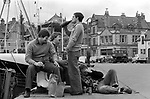Alcohol abuse, drunk fishermen Lerwick harbour 1970s Shetland islands.