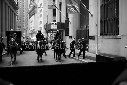 New York, New York<br /> November 17, 2011<br /> <br /> &quot;Occupy Wall Street&quot; protesters mark the movement's two-month milestone by marching from Zuccotti Park, in mass, to various access streets surrounding the New York Stock Exchange, which the police had barricaded off. Yet instead of the police keeping protesters out, protesters locked down those entrances to Wall Street and the New York Stock Exchange creating havoc as the police made more then 240 arrests to try and keep the streets open to normal traffic.<br /> <br /> Protesters are meet with barricades, police on houses and baton wielding riot police at Nassau just one block form the NYSE.