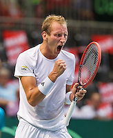 Switserland, Genève, September 18, 2015, Tennis,   Davis Cup, Switserland-Netherlands, Thiemo de Bakker (NED) takes the third set in his match against Stan Wawrinka, Netherlands lead 2-1 in sets<br /> Photo: Tennisimages/Henk Koster