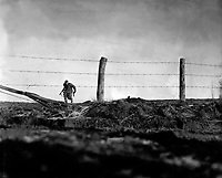 Infantryman goes out on a one-man sortie, covered by a buddy in the background.  82nd Airborne Division, Bra, Belgium. December 24, 1944. Edgren. (Army)<br /> NARA FILE #:  111-SC-197861<br /> WAR &amp; CONFLICT BOOK #:  1073