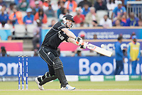James Neesham (New Zealand) lofts to wide long on during India vs New Zealand, ICC World Cup Semi-Final Cricket at Old Trafford on 9th July 2019