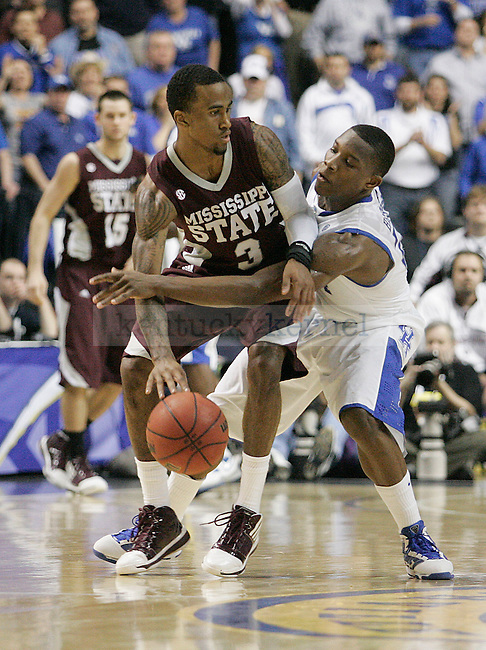 Freshman guard Eric Bledsoe fights Dee Bost for possession of the ball in the second half of UK's win 75-74 over Mississippi State  Bridgestone Arena in the SEC Finals on Sunday, March 14, 2010. Photo by Britney McIntosh | Staff