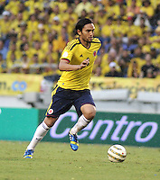 BARRANQUILLA - COLOMBIA - 11 -06-20: Abel Aguilar, mediocampista de Colombia en accion durante partido en el estadio Metropolitano Roberto Melendez de la ciudad de Barranquilla, junio 11 de 2013. Colombia y Peru disputan partido en la fecha 14 de la jornada clasificatoria a la Copa Mundo FIFA Brasil 2014. (Foto: VizzorImage / Luis Ramirez / Staff). Abel Aguilar, midfielder of Colombia in action during a game in the Metropolitan stadium Roberto Melendez in Barranquilla, June 11, 2013. Colombia and Peru disputing a match on the date 14 of the qualifying for FIFA World Cup Brazil 2014. (Photo: VizzorImage / Luis Ramirez / Staff.)