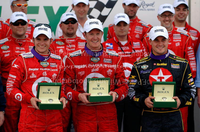 (L to R): Dan Wheldon, Scott Dixon and Casey Mears in Victory Lane with their Rolex watches.