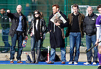 Former Hampstead players Rob Turner (Far L) and Nigel Land (Far R) look on during the England Hockey League Mens Semi-Final Cup game between Hampstead & Westminster and Sevenoaks at the Paddington Recreation Ground, Maida Vale on Sun March 21, 2010